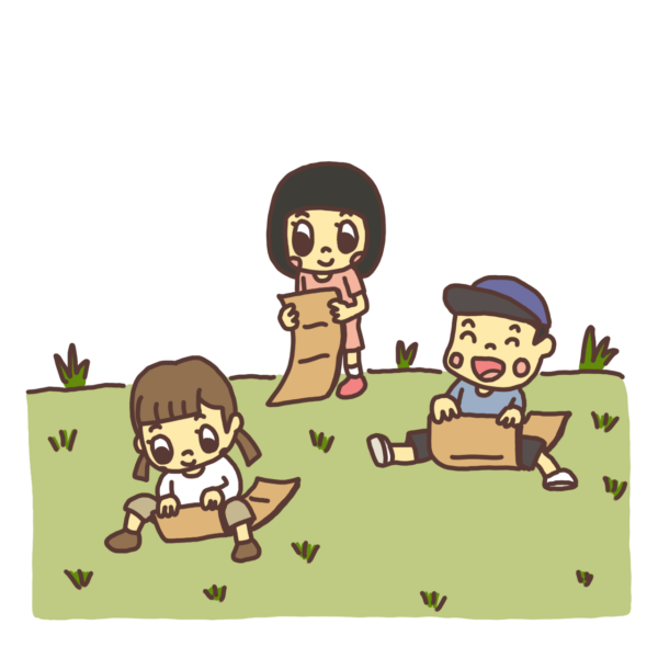 ダンボールで土手を滑る子どものイラスト